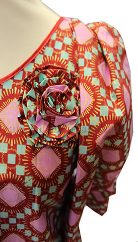 taifabricsafricanwomenclothespinkpattern